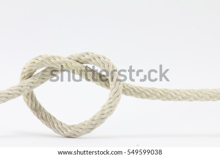 heart shape knots of rope isolated on white background