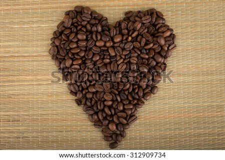 Heart shape made by coffee beans - stock photo