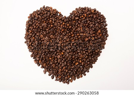 Heart shape made from coffee beans.