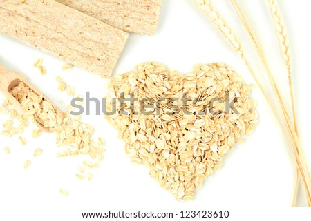 Heart shape made from oat flakes with oat biscuits and ears isolated on white - stock photo