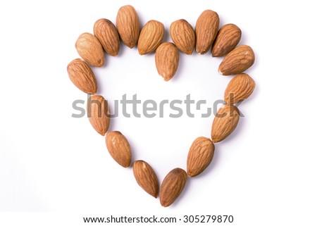 Heart shape made of almonds - stock photo