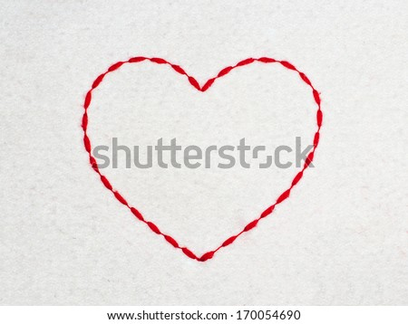 Heart shape made of red thread - stock photo