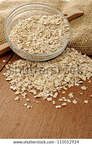 Heart shape oatmeal on wooden background. Good for healthy food concept - stock photo