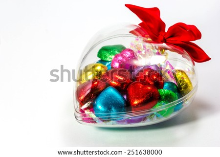 Heart shape of chocolate candy on white background - stock photo