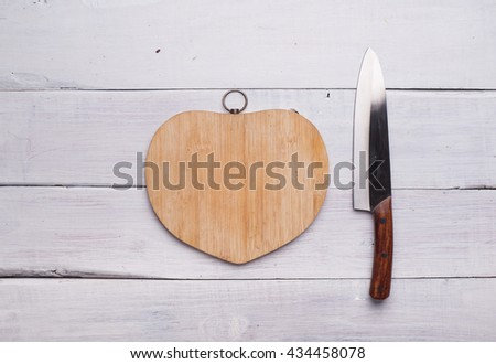 Heart shape of chopped celery and fresh vegetables, on wooden background - stock photo
