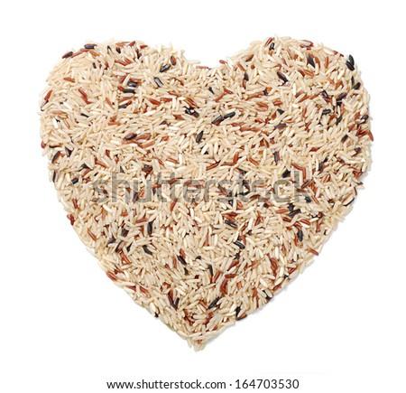 Heart Shape of Organic Brown Rice - stock photo
