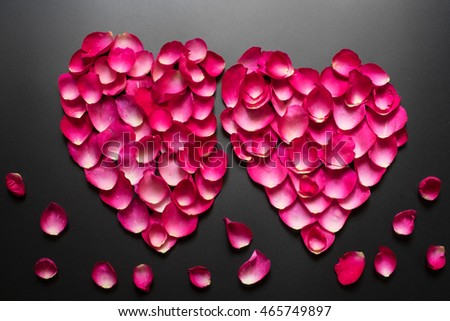 Heart shape of pink rose petals on black color, Vintage photography with Rose petals, Valentine's day with beautiful rose petals, Overhead view
