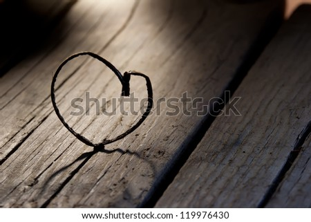 Heart shape on a old wood planks - stock photo
