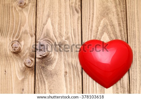 heart shape on grunge wooden background with copy space - stock photo