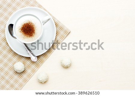 Heart shape on latte over the wooden table - stock photo