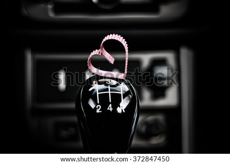 heart shape on manual gearbox in the car - stock photo