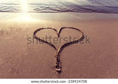 heart shape on sand at beach