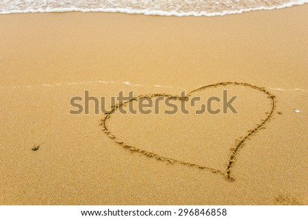 heart shape on the beach in sunshine day
