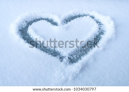 Heart shape on the white snow