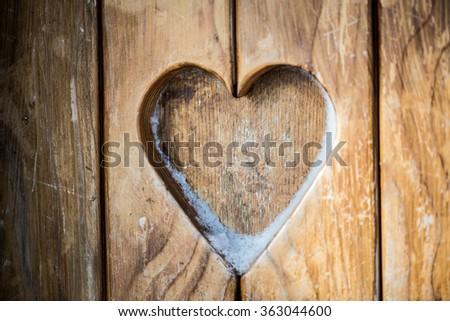 Heart shape on wooden wall - stock photo