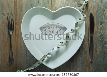 Heart shape plate with weighing scales and tape measure