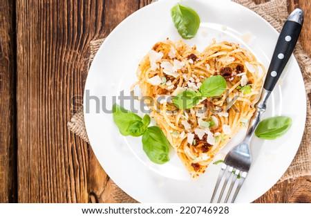 Heart Shape Spaghetti with fresh homemade Tomato Pesto - stock photo