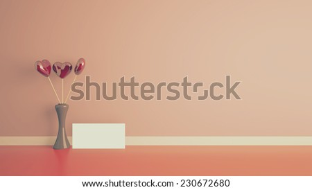 heart shape toy inside vase in empty interior with a cream wall and blank card - stock photo