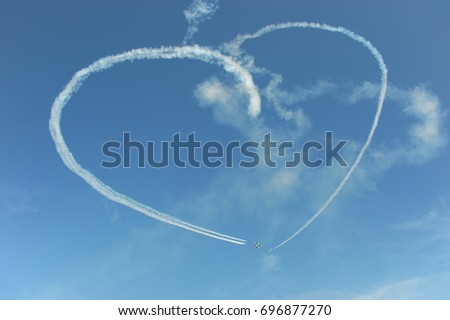 heart shape trace in the sky in the air show