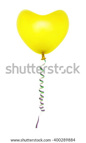 Heart shaped balloon and streamer isolated on white background - stock photo