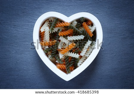 Heart shaped bowl filled with Tri Color Fusilli