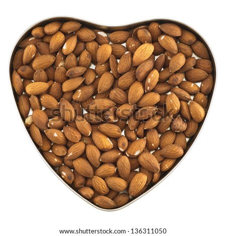 Heart shaped box full of almond nuts isolated over white background, top view