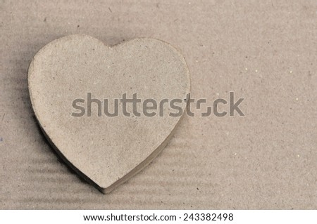 heart shaped box recycled cardboard on cardboard background - stock photo