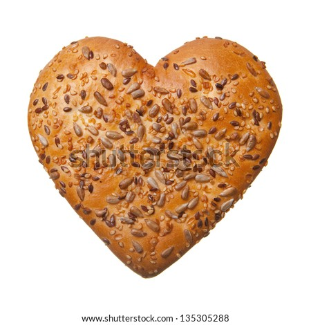 Heart shaped bun with sesame and sunflower seeds isolated on white - stock photo