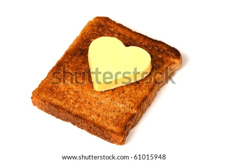 Heart Shaped Butter on wholemeal Toast on white background - stock photo
