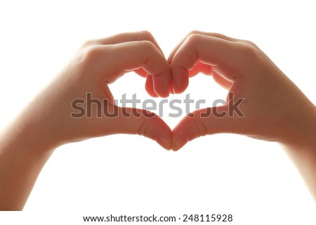 Heart shaped by child hands isolated on white - stock photo