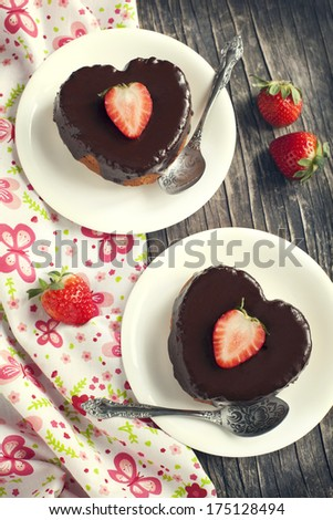 Heart shaped cakes with chocolate and strawberry - stock photo