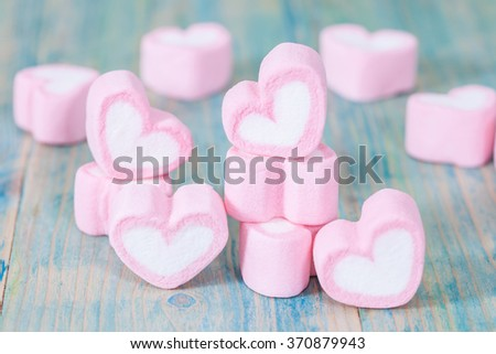 heart shaped candies on background,selective focus.