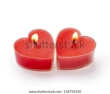 Heart shaped candle burning - stock photo