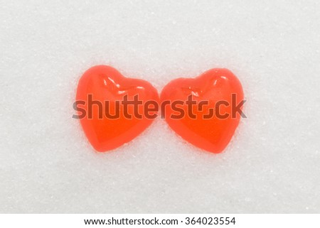 heart-shaped candy on the sugar