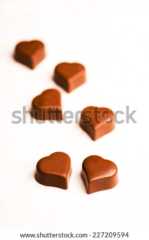 Heart shaped chocolate candies - shallow DOF - stock photo