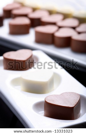 Heart-shaped chocolates. Short depth-of-field.