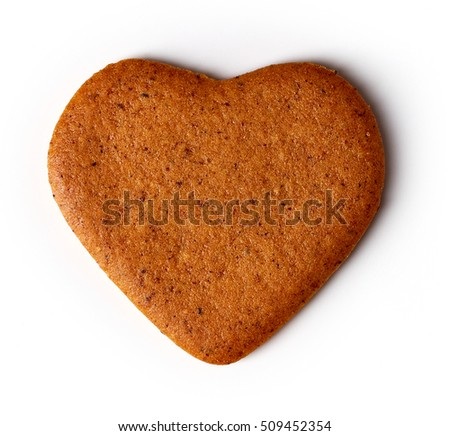Heart shaped christmas cookie isolated on white background, top view
