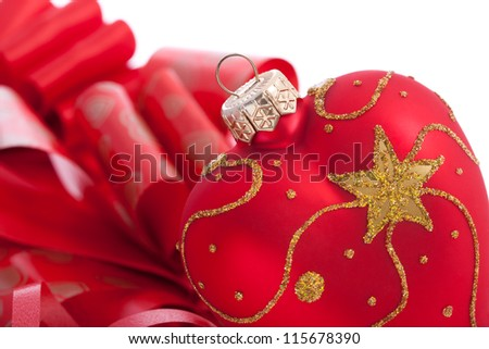 Heart shaped Christmas decoration with ribbons on white background.