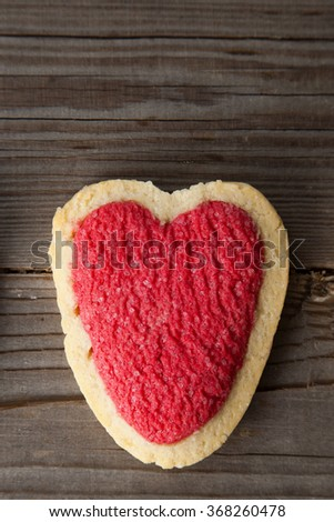 Heart shaped cinnamon cookie on wooden background - stock photo