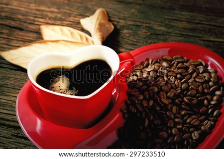 Heart shaped coffee mug with plate and coffeen beans love valentine concept - stock photo
