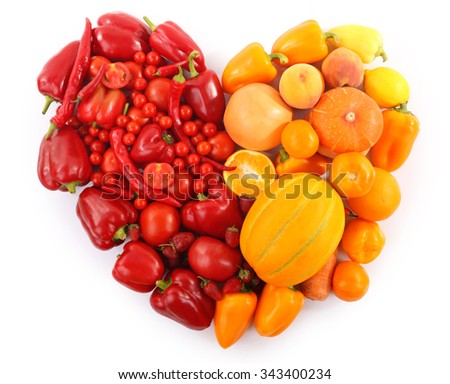 Heart-shaped composition of various raw organic vegetables isolated on white