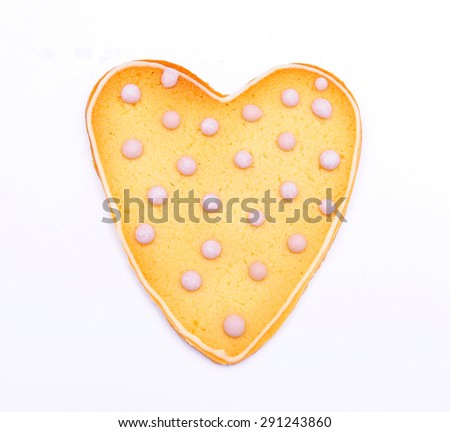Heart shaped cookie with pink sugar icing isolated on white background - stock photo