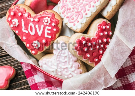 Heart shaped cookies baked on Valentines Day on the table - stock photo
