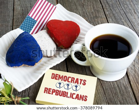 Heart shaped cookies color red, blue, white. Cup of coffee (tea), USA flag, decoration on old wooden table. Patriotic Breakfast Concept - 2016 USA presidential election Republicans or Democrats - stock photo
