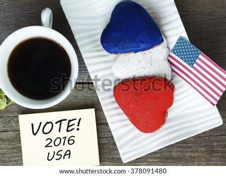 Heart shaped cookies color red, blue, white. Cup of coffee (tea), USA flag, decoration on old wooden table. Patriotic Breakfast Concept - VOTE 2016 USA - stock photo