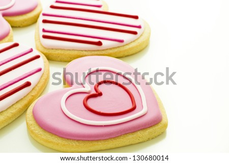 Heart shaped cookies decorated fancy icing patterns. - stock photo