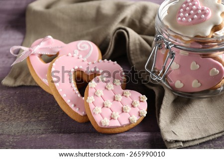 Heart shaped cookies for valentines day in glass jar on  wooden background - stock photo