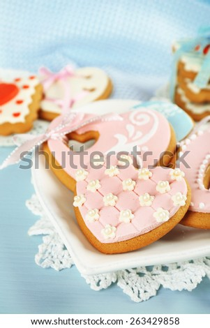 Heart shaped cookies for valentines day on plate, on color wooden background - stock photo