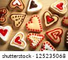 Heart shaped cookies on wooden table background - stock photo