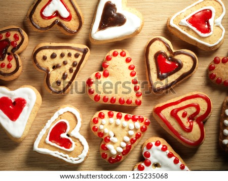Heart shaped cookies on wooden table background